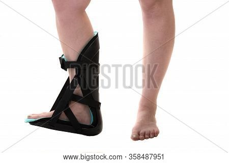 Close Up Of Woman Leg With Adjustable Ankle Foot Orthosis Brace,night Splint Isolated On White Backg