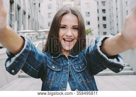 Cheerful Young Carefree Woman Making Selfie On Camera And Smiling While Having Fun Outdoors. Beautif