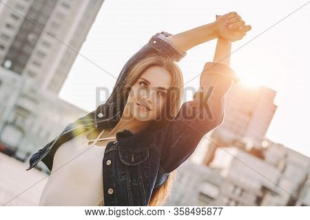 Fashionable Beautiful Hipster Girl In Stylish Denim Jacket And Dress Walking And Posing On Sunny Cit