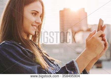 Happy Attractive Hipster Girl Taking Photo On Cell Phone And Smiling On City Street. Beautiful Trend