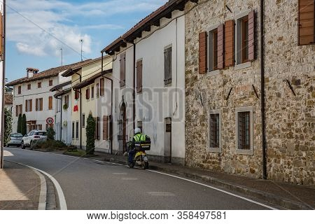 Manzano, Italy - 25.03.2020: Little Italian City During An Epidemic. On The Street There Is Nobody J