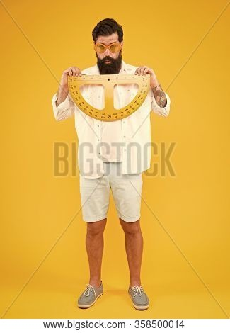 Back To School And Back To Maths. School Teacher Holding Measuring Instruments On Yellow Background.