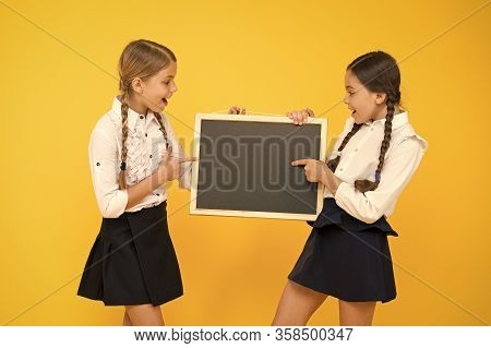 Learning Fun At Lesson. Cute Small Schoolchildren Reciting Lesson At Blackboard On Yellow Background