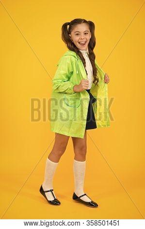 Schoolgirl In Green Cloak. Enjoy Fall Weather With Proper Garments. Waterproof Accessories Make Rain