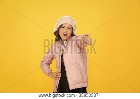 Hey You. Little Girl Pointing Finger. Small Child Pointing Yellow Background. Pointing Gesture As No