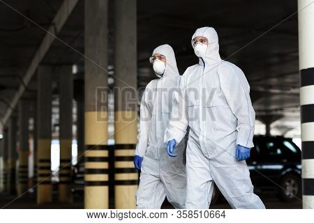 Quarantine, Coronavirus Infection. Medical Workers In Protective Mask And Suits Going In Empty City