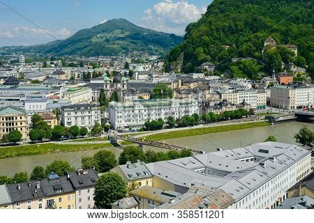 View Of Salzburg On The East Bank Of The Salzach River At The Base Of The Kapuzinerberg With Its Cap