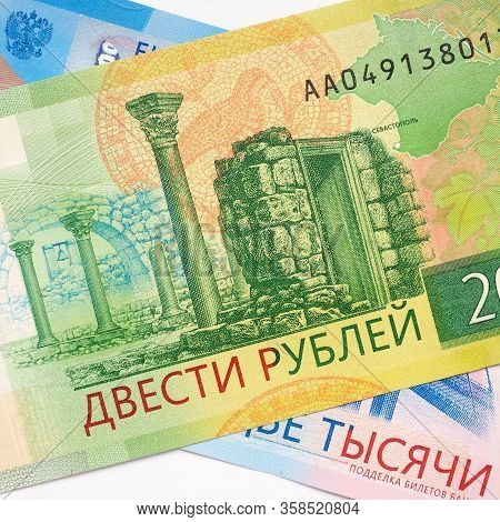 Russian Banknote 200 Rubles Lies On The Banknote 2000 Rubles. The Banknote Depicts The Sights Of Cri