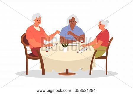 Happy Elderly Playing Bingo Together. Old Woman Playing Bingo