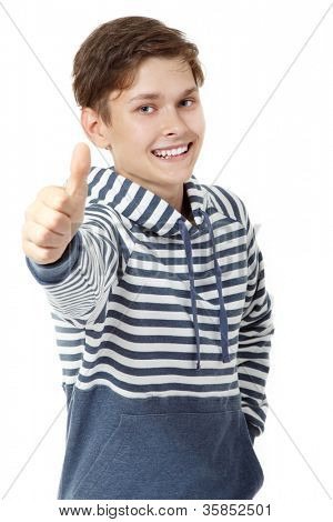 Cheerful attractive teen boy thumb up over white background