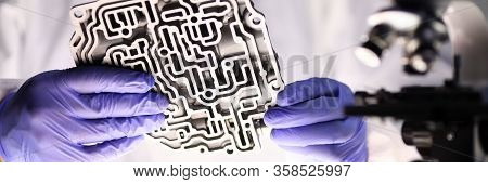 Man Holds Metal Part From Automatic Transmission. Transmission Service Repair Center Master Identifi
