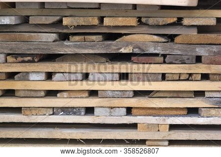 Short Clipped Boards Lie In Pallets. They've Been Cut Recently.background