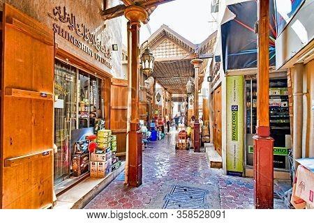 Dubai, United Arab Emirates - February 13, 2018: Customers Stroll Through A Covered Alley Of A Tradi