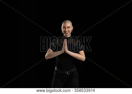 Praying, Smiling. Monochrome Portrait Of Young Caucasian Bald Woman Isolated On Black Studio Backgro