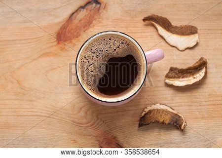 Mushroom Coffee Chaga Superfood. Dried Mushrooms And Fresh Brewed Cup Of Hot Drink On Wooden Backgro