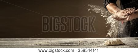 Photo Of Flour And Men Hands With Flour Splash. Cooking Bread. Kneading The Dough. Isolated On Dark
