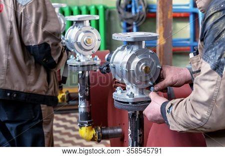 Fitter Installs A Gas Shutoff Valve In The Boiler Room.