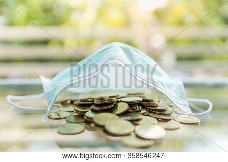 Money, Business, Healthcare In Cornavirus (covid-19) Situation Concept. Pile Of Gold Coins Under Sur