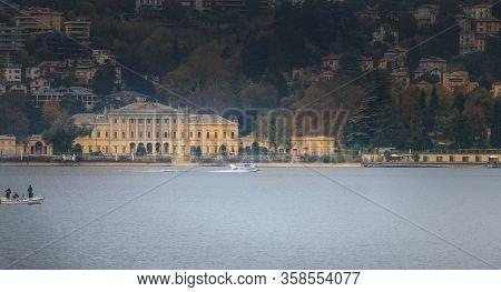Como Near Milan, Italy - November 4, 2017: Passenger Seaplane Landing On Lake Como Among Small Fishe