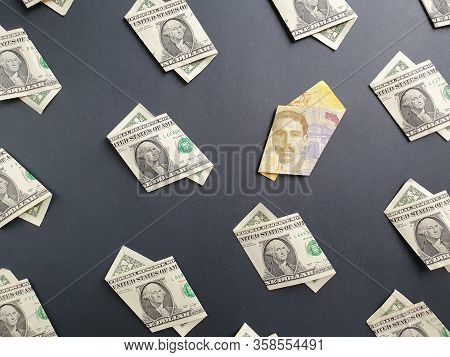 American One Dollar Bills And Costa Rican Banknote Of 5000 Colones On The Black Background
