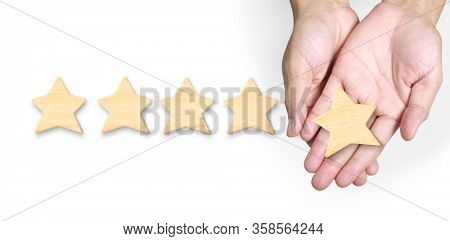 Hand of putting increase five star shape.The best excellent business services rating customer experience concept