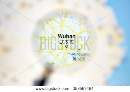 Ostersund, Sweden - Mars 28, 2020: Wuhan on Google Maps under a magnifying glass.  Wuhan is the city at the center of coronavirus.