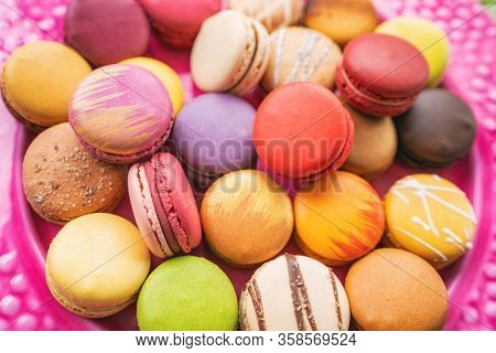 Many macarons closeup on table. Numerous colorful french macaron pastries.