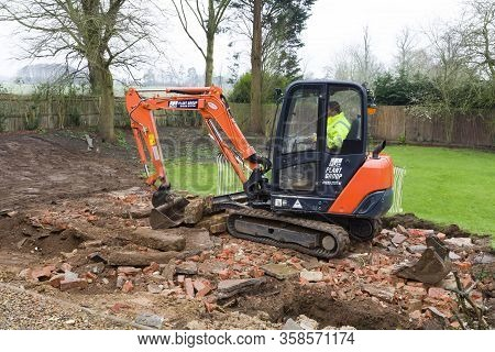 Buckingham, Uk - February 13, 2016. Digger, Bulldozer Clearing Rubble In Preparation For Hard Landsc