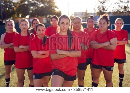 Portrait Of Womens Football Team Training For Soccer Match On Outdoor Astro Turf Pitch