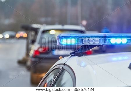 Blue Lights Of A Police Car At The Scene Of An Accident