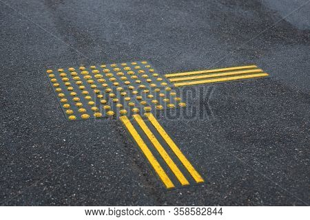 Walkway For Blindness People. Bright Yellow Tactile Paving For The Visually Impaired On The Road. Si