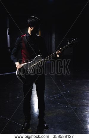 Bass Guitar Player In Black Clothes And Red Gillette In Dark Hall Gothic Red And Black Aesthetic The