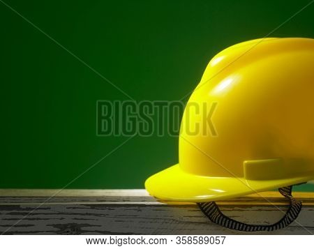 Safety first concept yellow hard safety wear helmet hat -with copy space