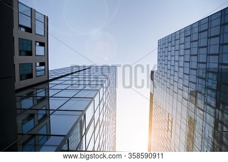 Skyscraper, Modern Building In The City With Sunlight. Glass Wall Of An Office Building In The Sunli