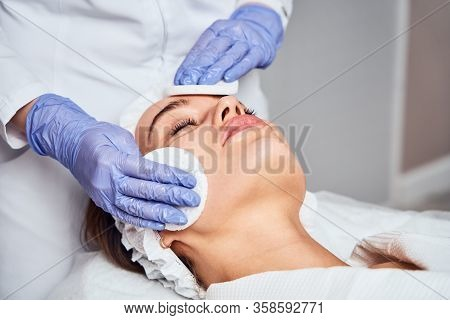 Face Skin Care. Close-up Of Woman Getting Facial Hydro Microdermabrasion Peeling Treatment At Cosmet