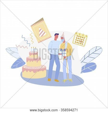 Young Man, Holding Gift Box In Hands, Hugging And Congratulating His Senior Friend, Grandad Or Dad O