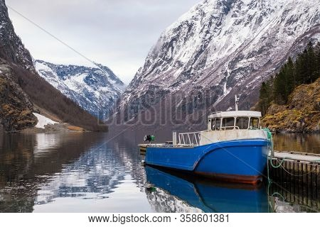 Fishing boat in Naeroyfjord in Gudvangen village, Norway.