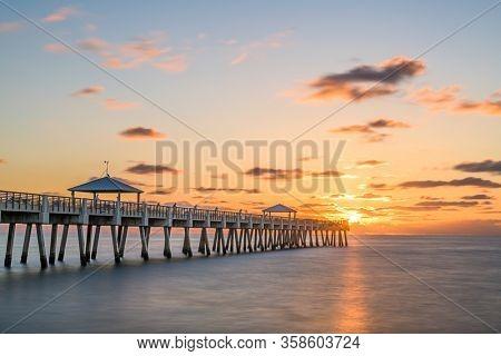 Juno, Florida, USA at the Juno Beach Pier during sunrise.