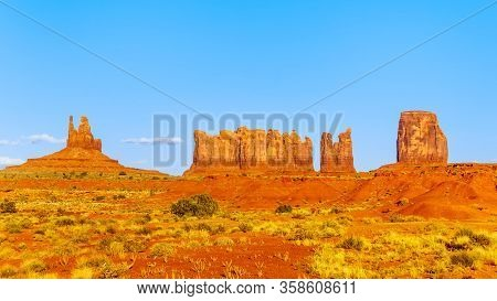 The Sandstone Formations Of Mitten Buttes And Cly Butte In The Desert Landscape Of Monument Valley N