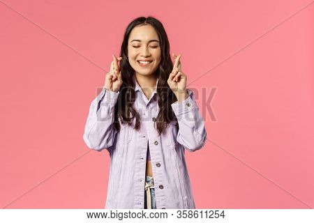 Hope My Wish Come True. Portrait Of Hopeful Enthusiastic, Attractive Young Asian Girl Praying, Daydr