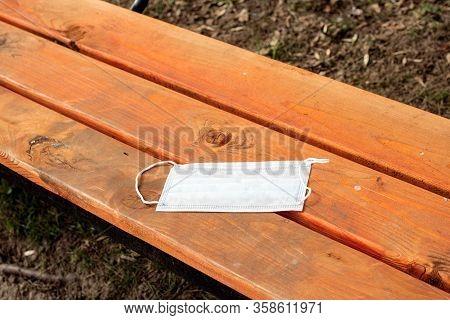 Protective Medical Mask Forgotten On Park Bench