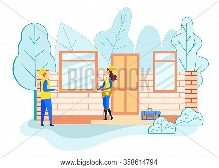 Builders Man And Woman Holding Tape Measuring Window Size On Unfinished Cottage Building. Craftsman