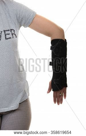 Close Up Of Woman With Left Hand Orthosis Isolated On White Background