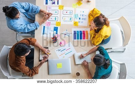 Top View Ux Developer And Ui Designer Brainstorming About Mobile App Interface Wireframe Design On T