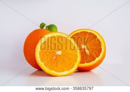 Juicy Orange On A White Background Orange Fruit With Orange Slices And Leaves Isolated On A White Ba
