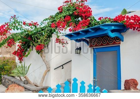 Traditional Architecture In Akrotiri Village On Santorini Island Greece. White House Blue Doors Boug