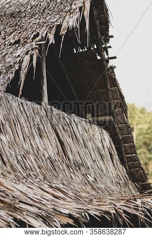 Cozy Wooden Shack With Roof Made From Straws In Thailand During Cloudy Day