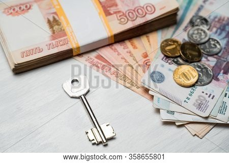 The Key Lies Next To The Bundles Of Russian Rubles, Russian Rubles And A Home Key, House Key And Rus
