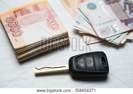 Car Key Lies On A Table With Rubles Banknotes, Russian Rubles And A Car Key