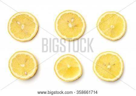 Top View Of Textured Ripe Slice Of Lemon Isolated On White Background